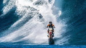 man surfs with motocycle