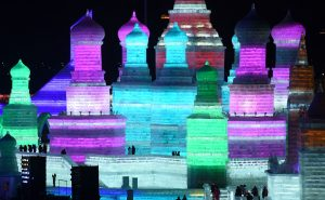 TOPSHOT - Visitors walk through the China Ice and Snow World during the Harbin International Ice and Snow Festival in Harbin, northeast China's Heilongjiang province on January 5, 2016. Over one million visitors are expected to attend the spectacular Harbin Ice Festival, where buildings of ice are bathed in ethereal lights and international ice sculptors compete for honours.     AFP PHOTO / WANG ZHAO / AFP / WANG ZHAO        (Photo credit should read WANG ZHAO/AFP/Getty...<a href=